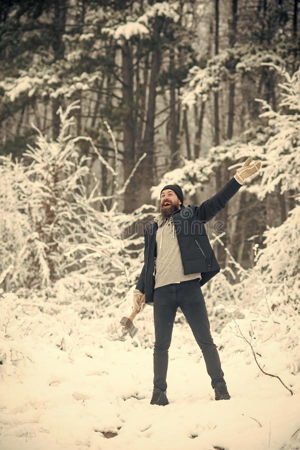 Skincare and beard care in winter, beard warm in winter. Man lumberjack with ax. Temperature, freezing, cold snap, snowfall. Camping, traveling and winter rest stock images