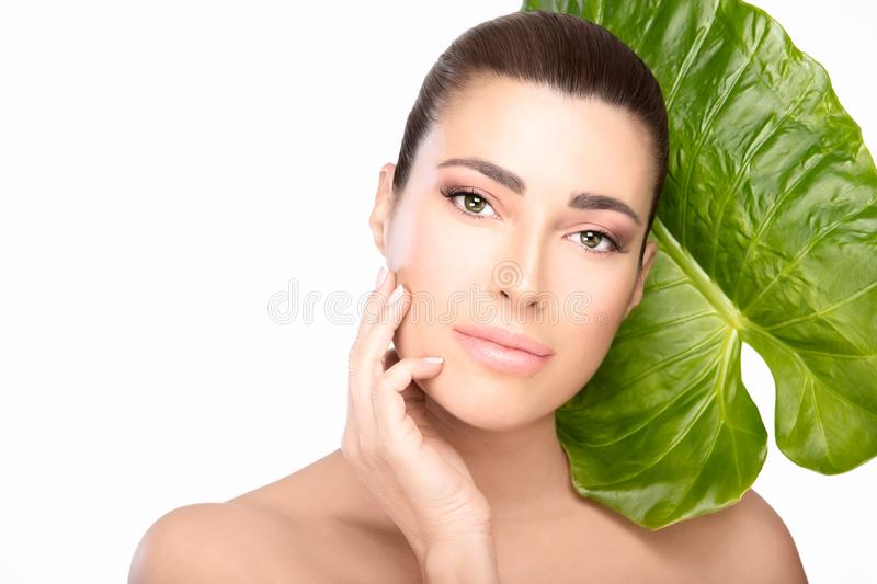 Skincare concept. Beauty spa woman and green leaf royalty free stock images
