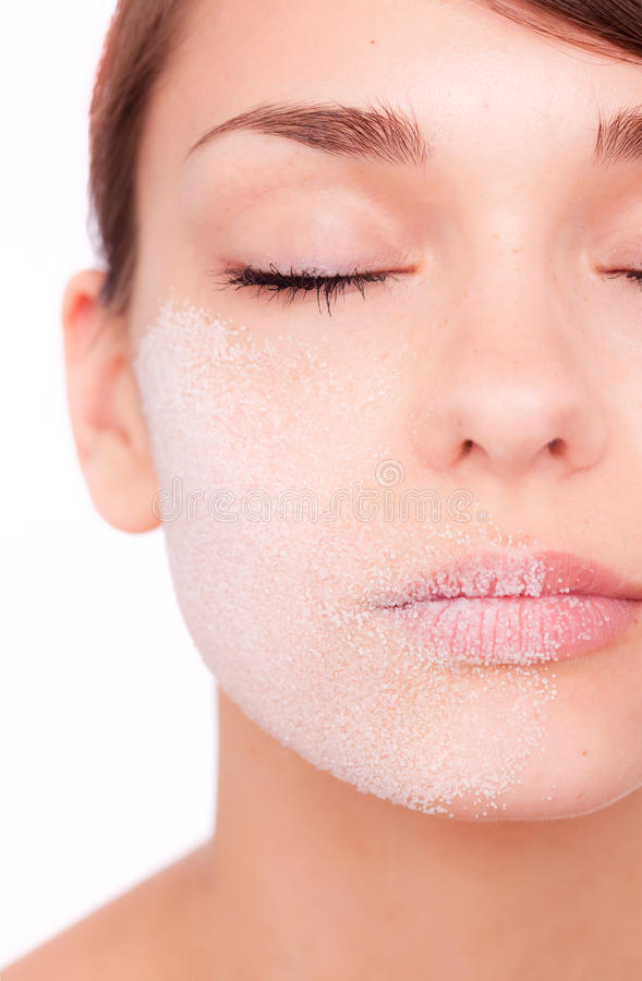 Skincare dry facial. Close-up of young female head with drying skin royalty free stock photography