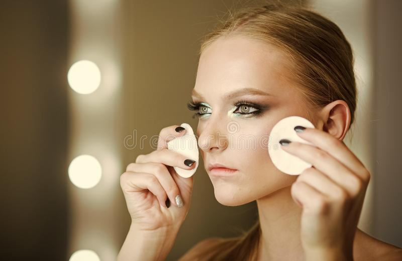 Skincare model with cotton pads. Skincare for pretty woman face skin, treatment, therapy stock photo