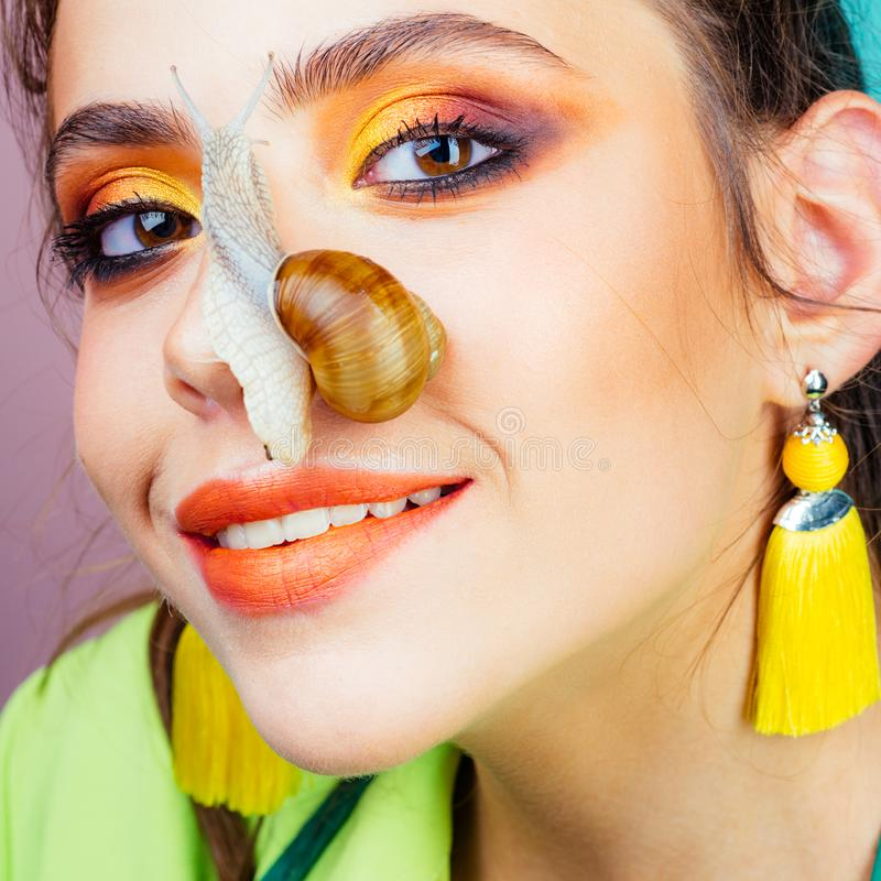Skincare repairing. Healing mucus. Having fun with adorable snail. Cosmetics and snail mucus. Cosmetology beauty. Procedure. Girl fashionable makeup face and stock photos