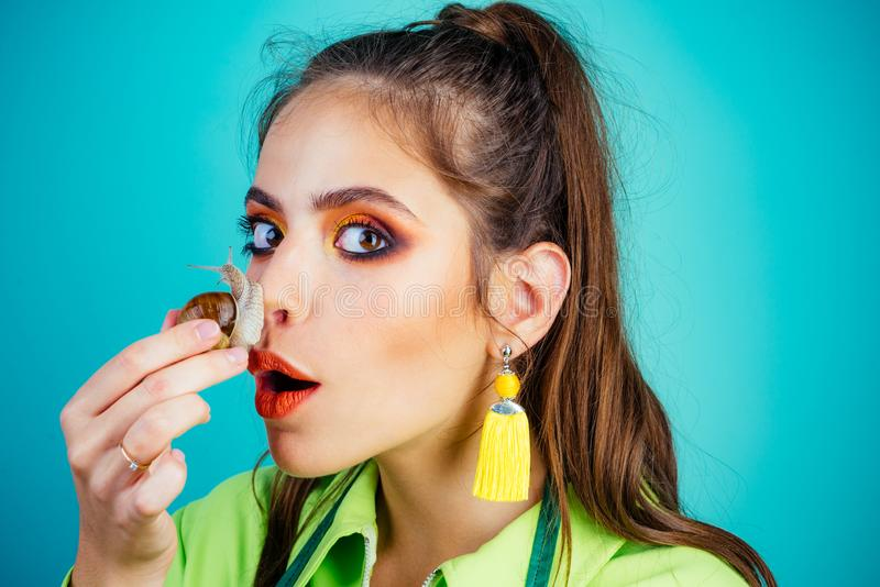 Skincare repairing. Healing mucus. Having fun with adorable snail. Cosmetics and snail mucus. Girl fashionable makeup. Face and cute snail. Cosmetology beauty stock photography