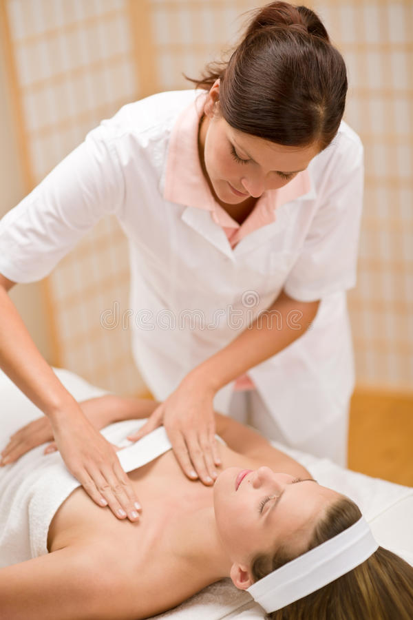 Skincare - woman cleavage massage at salon. In day spa royalty free stock photos