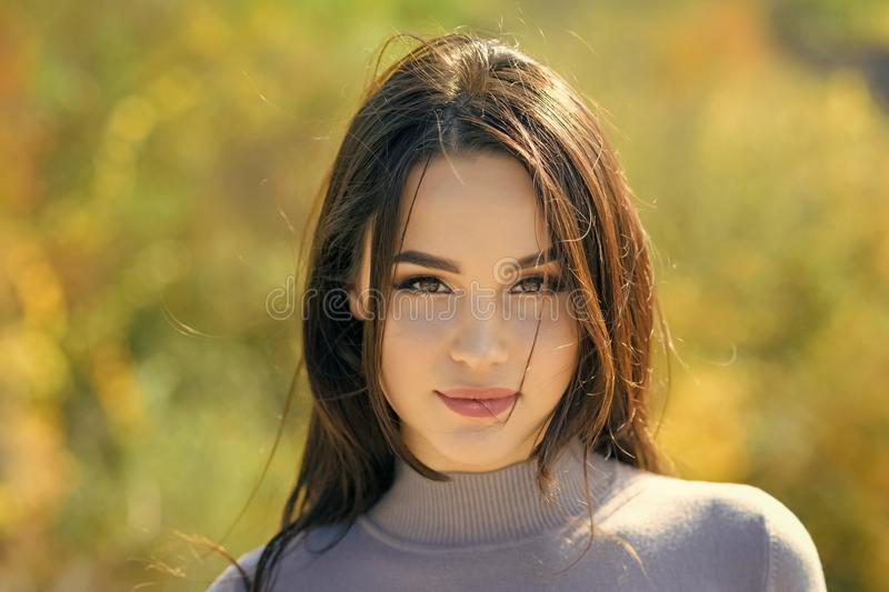 Skincare, youth, health. Energy, joy, serenity. Woman with long brunette hair. Girl with makeup face smiling on sunny royalty free stock images