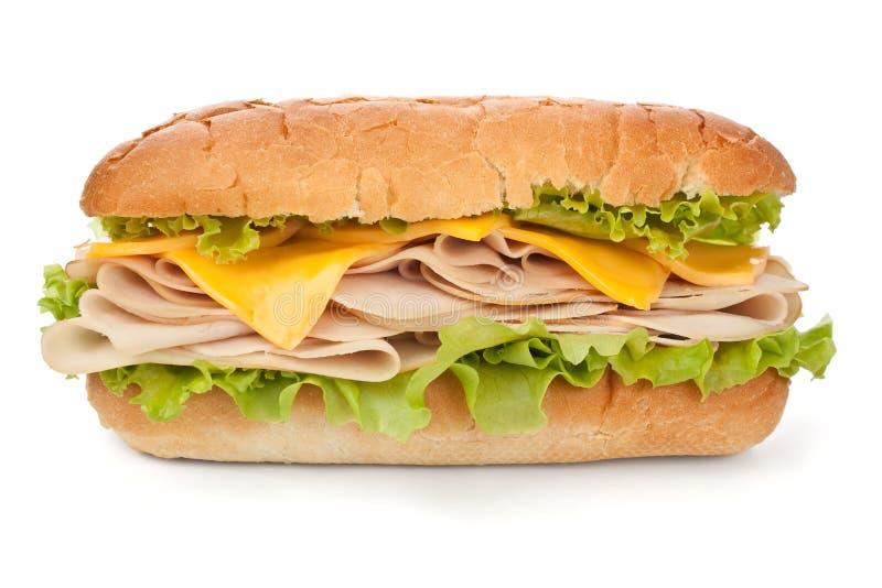 Skinka för Turkiet bröst, ost och grönsallatsmörgås arkivbild