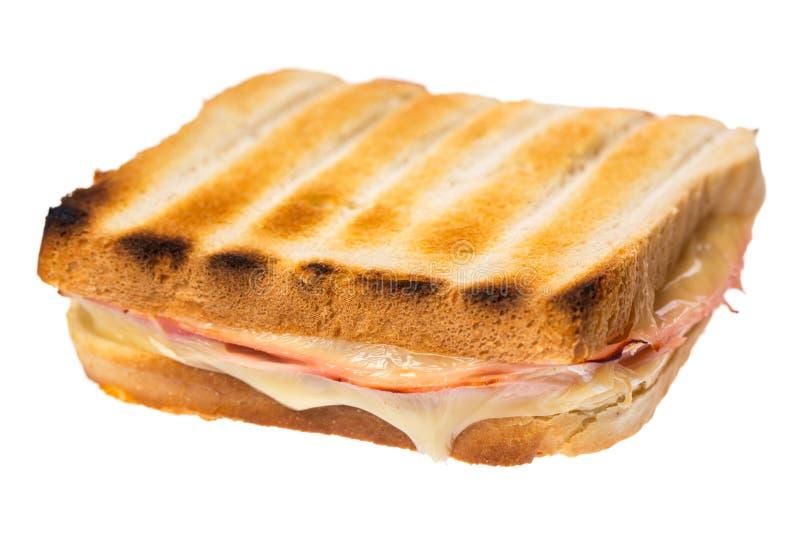 Skinkaost på rostat bröd som isoleras på diagonal vit bakgrund royaltyfri foto