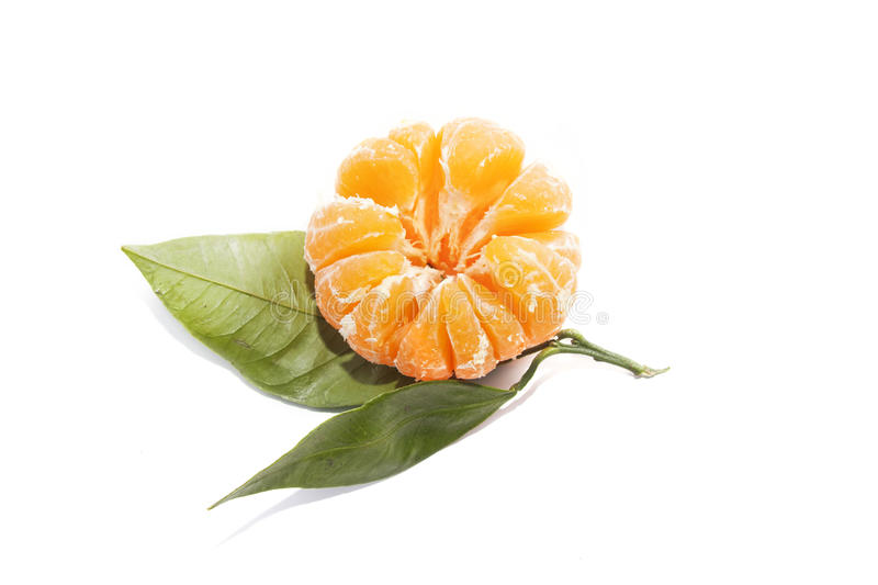 Skinless tangerine mandarin with leaf on white background. Skinless tangerine mandarin with leaf on a white background royalty free stock images