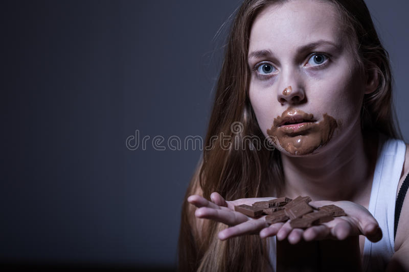 Skinny girl with dirty mouth. Photo of sick skinny girl with dirty mouth from chocolate royalty free stock photography