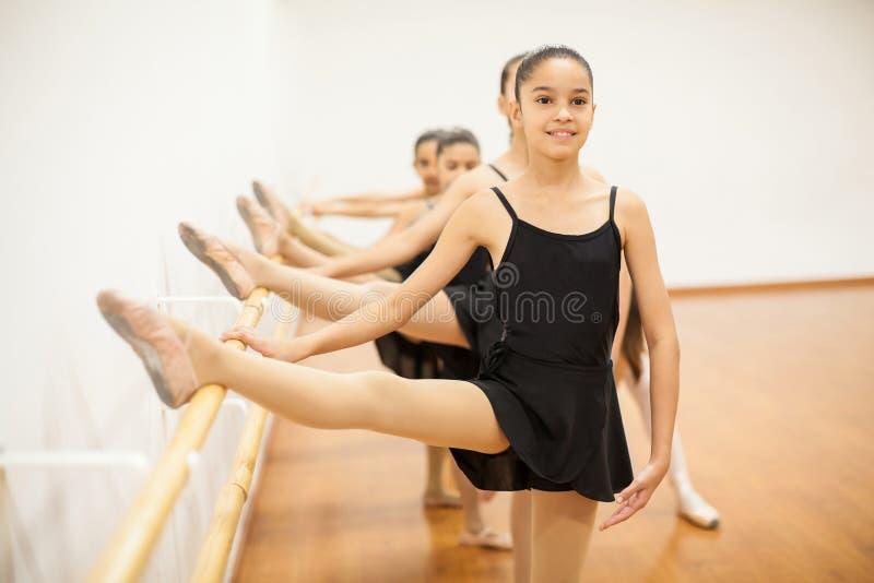 Skinny girl enjoying her ballet class stock image