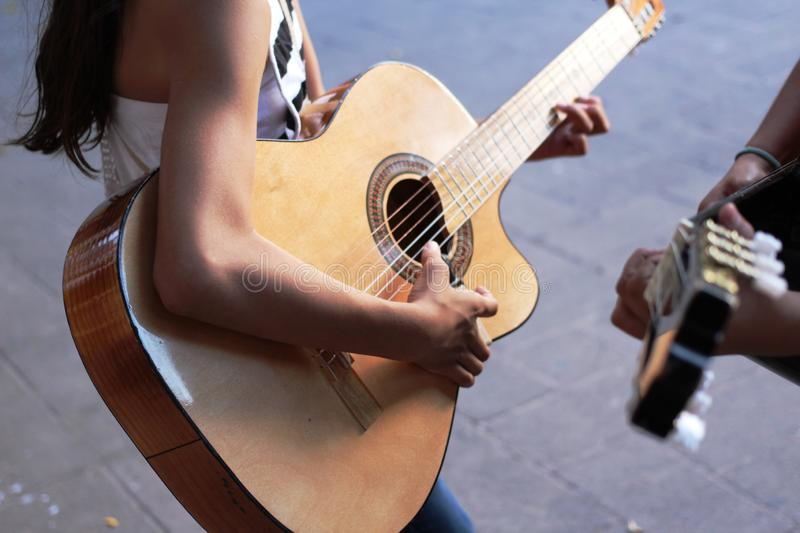 Skinny guitar player with an acoustic guitar stock images