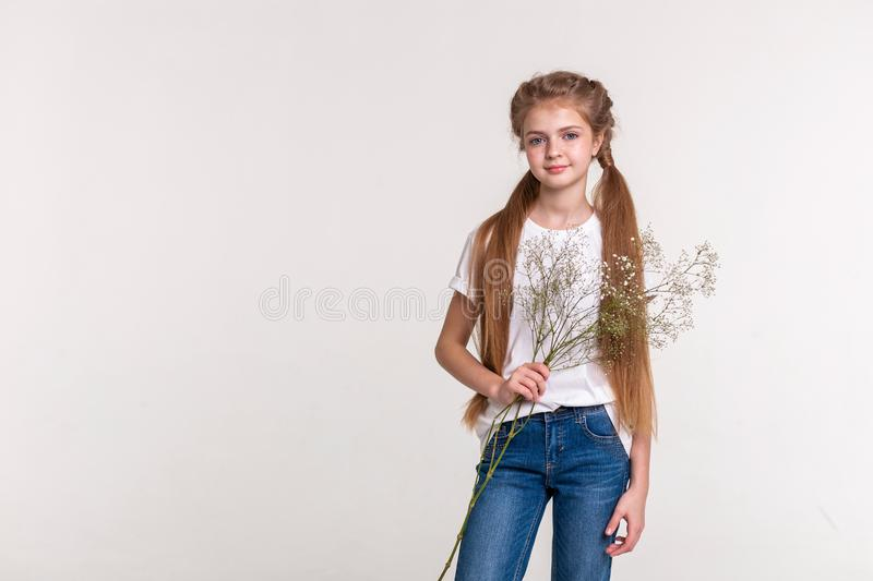 Skinny pretty girl with long light hair wearing blue jeans royalty free stock photos