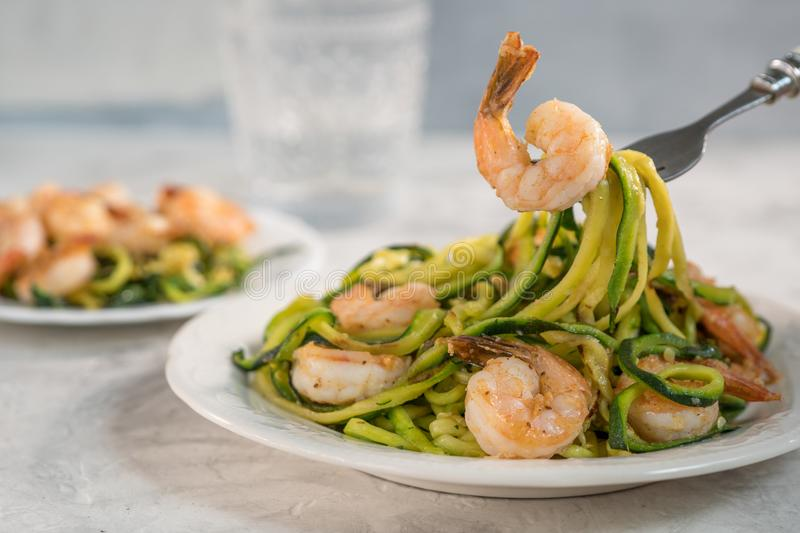 Skinny Shrimp Scampi with Zucchini Noodles. Low carb meal stock image