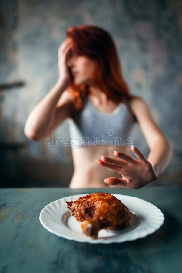 Skinny woman refuses to eat, anorexia. Skinny woman refuses to eat, absence of appetite. Fat or calories burning concept. Weight loss, anorexia stock photos