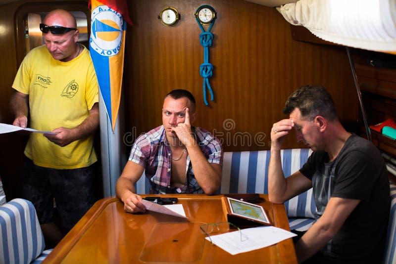 Skipper briefing during sailing regatta 16th Ellada Autumn 2016 among Greek island group in the Aegean Sea. MILOS, GREECE - SEP 25, 2016: Skipper briefing during stock image