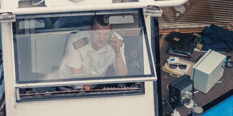 Skipper of a pleasure boat royalty free stock photo