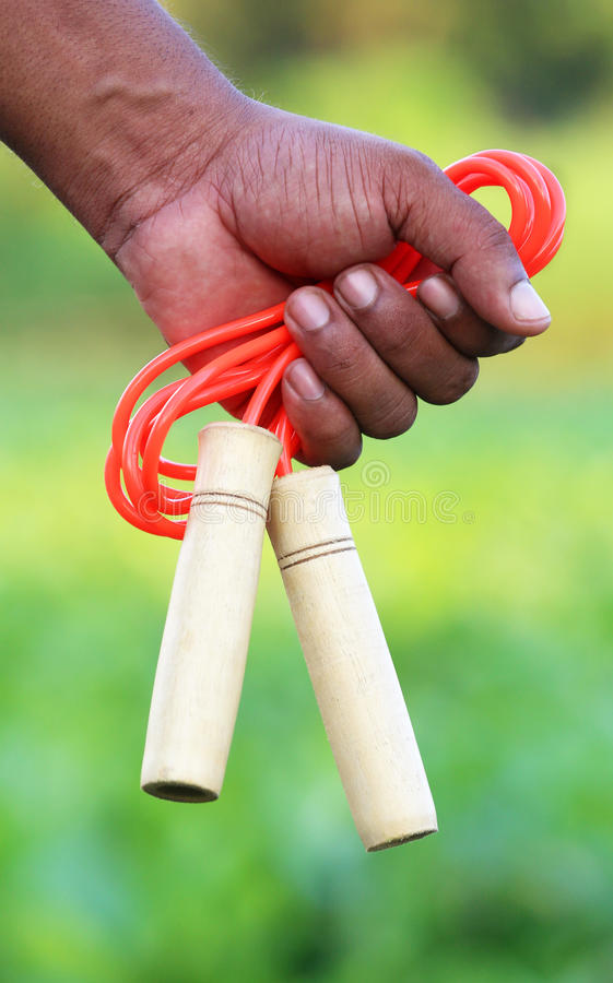 Skipping rope in hand. Hand holding a skipping rope royalty free stock images