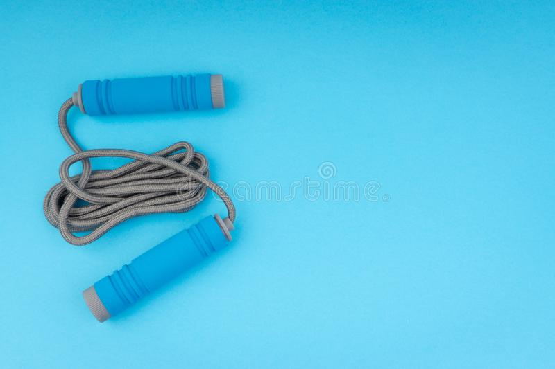 Skipping rope or jumping rope isolated on blue background. Selective focus and crop fragment royalty free stock images