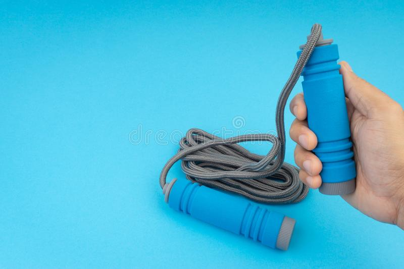 Skipping rope or jumping rope isolated on blue background. Selective focus and crop fragment royalty free stock photos
