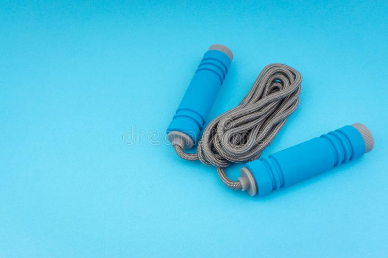 Skipping rope or jumping rope isolated on blue background. Selective focus and crop fragment stock photos
