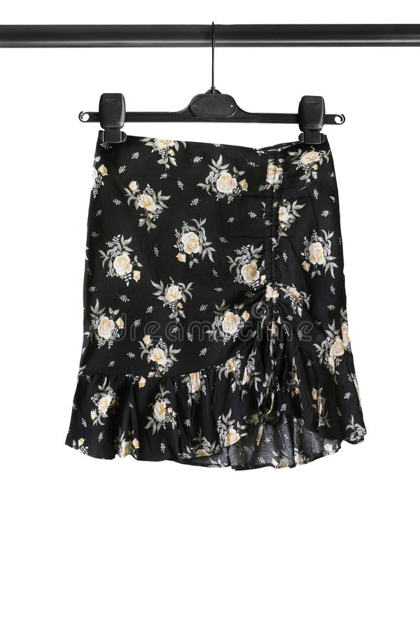 Skirt on clothes rack stock image