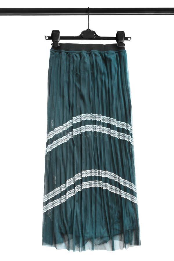 Skirt on clothes rack stock photos