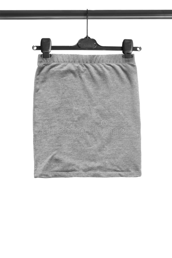 Skirt on hanger isolated royalty free stock photography
