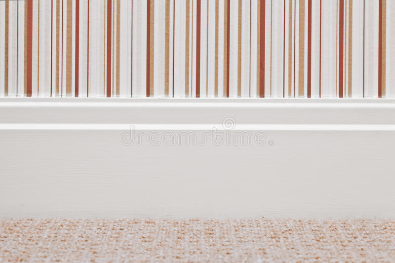 Skirting board. Modern white wooden skirting board royalty free stock images