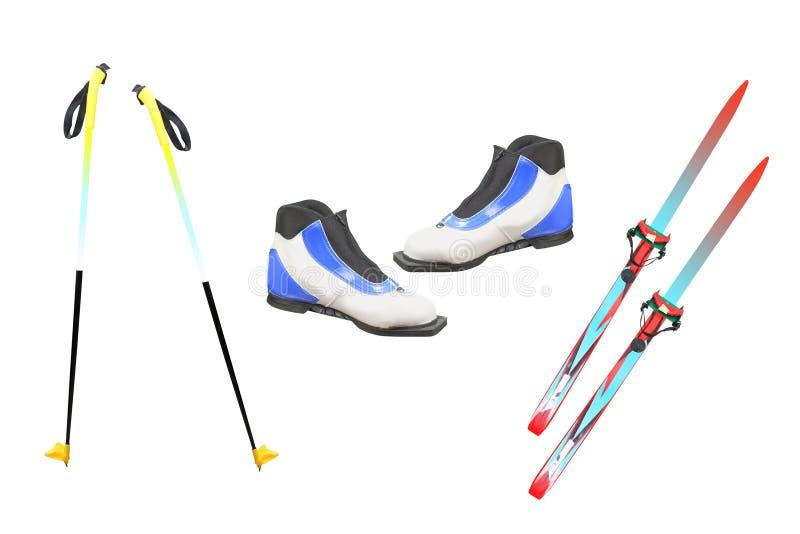 Skis, pôles de ski et bateaux de touristes photo stock