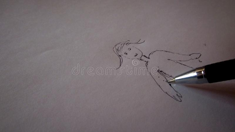 Skissa en flicka på vitbok royaltyfria foton