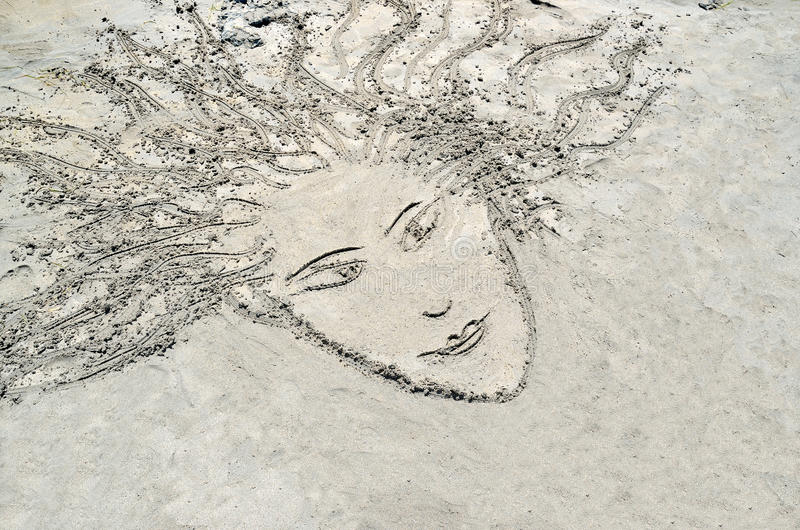 Skissa i sanden arkivbild