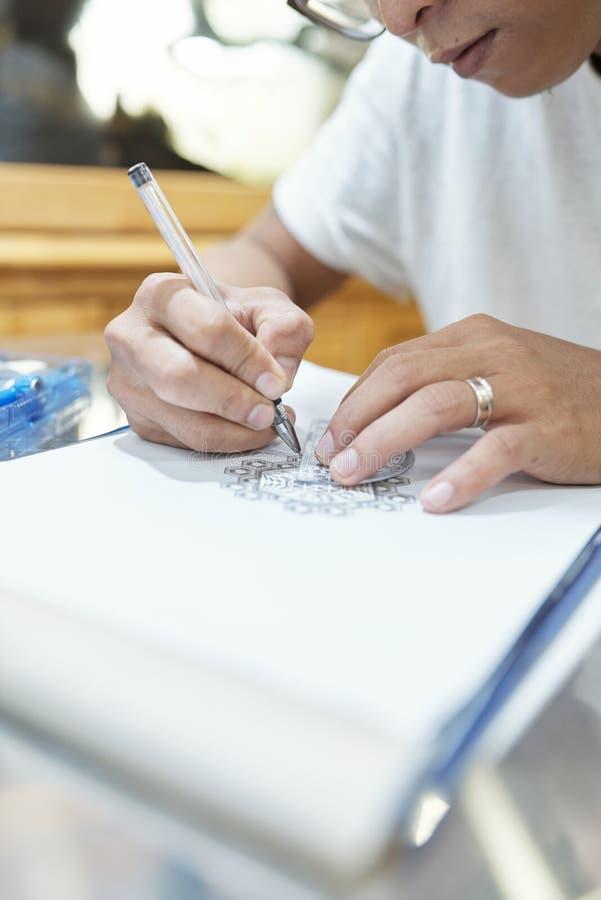 Skissa tatueringen arkivfoto