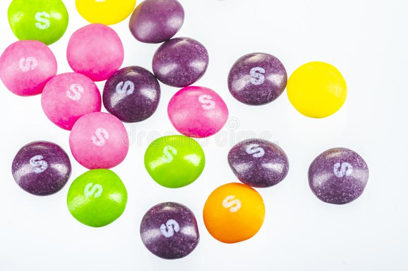 Skittles fruit-flavoured candies isolated on white background. Nowadays Skittles produced and marketed by the Wrigley Company Wrigley Company a division of stock images