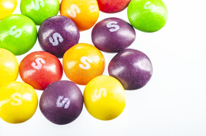 Skittles fruit-flavoured candies isolated on white background. Nowadays Skittles produced and marketed by the Wrigley Company Wrigley Company a division of stock photography