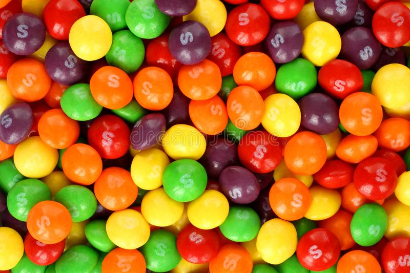 Skittles multicolored fruit candies background. Kiev, Ukraine - September 22, 2017: Skittles multicolored fruit candies background. Skittles is a brand of fruit stock images