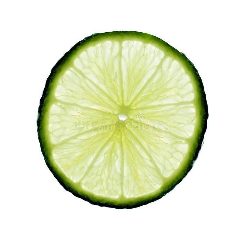 Skiva av högkvalitativ limefrukt - royaltyfria foton