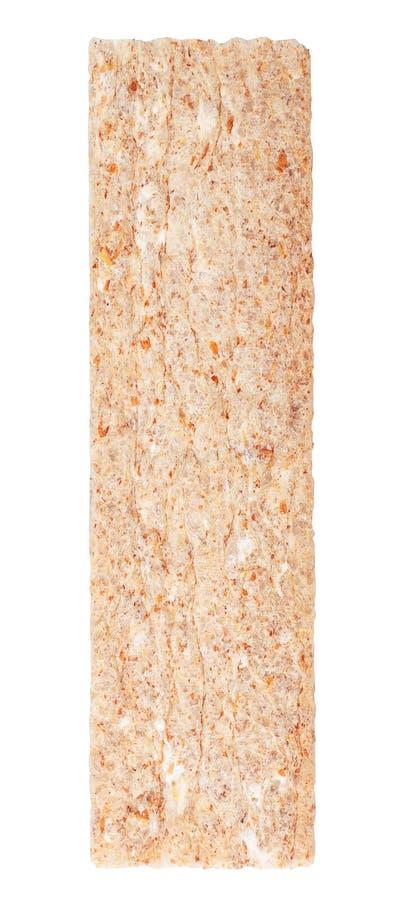 Skiva av knäckebrödet som isoleras på vit bakgrund arkivfoto