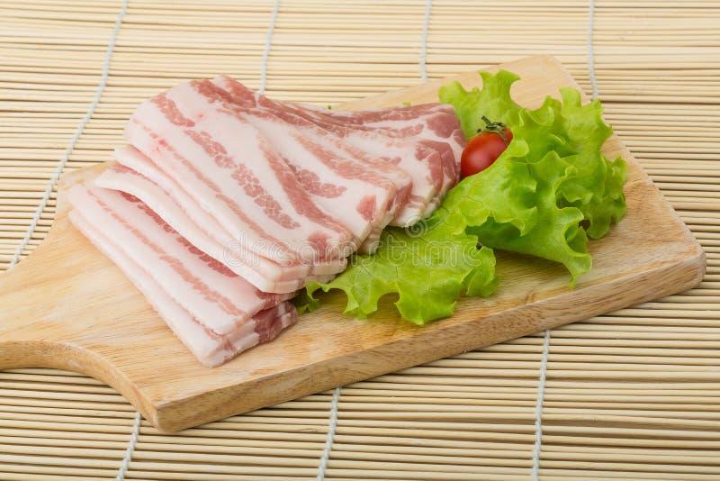 skivad bacon arkivfoton