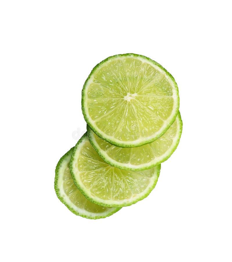 Skivad limefruktfrukt som isoleras på vit bakgrund royaltyfri foto