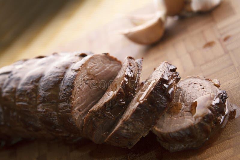 Skivad saftig nötköttfläskkarré arkivbilder