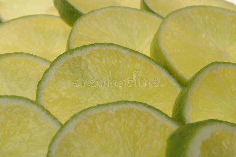 Download Skivade Bakgrundslimefrukter Fotografering för Bildbyråer - Bild av makro, nutritious: 975597