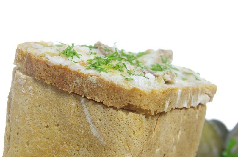 Skivan av bröd med späcker royaltyfri foto