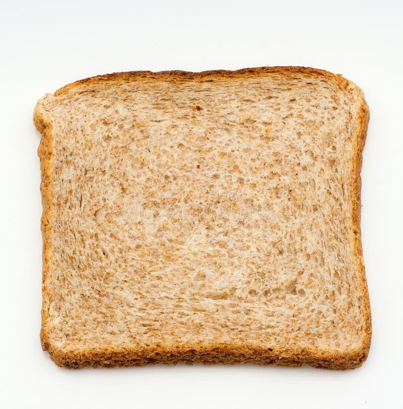 Skivan av bröd som ska rostas, isolerade på vit bakgrund close upp Top beskådar royaltyfri foto