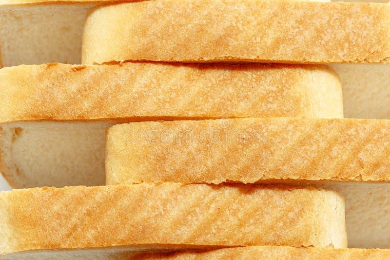 Skivat bröd som en bakgrund arkivbilder