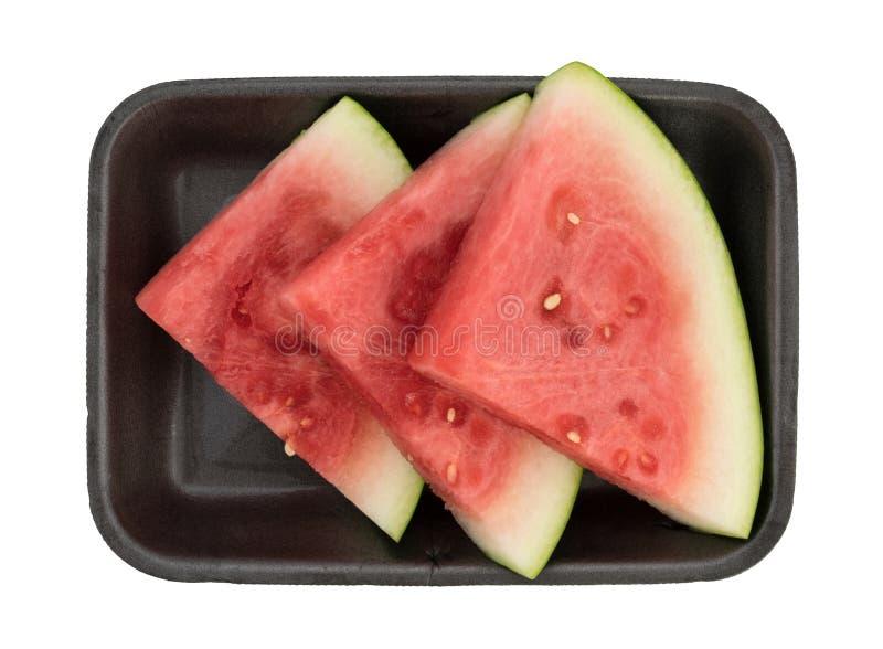 Skivor av den nya vattenmelon på ett svart skummagasin arkivfoto