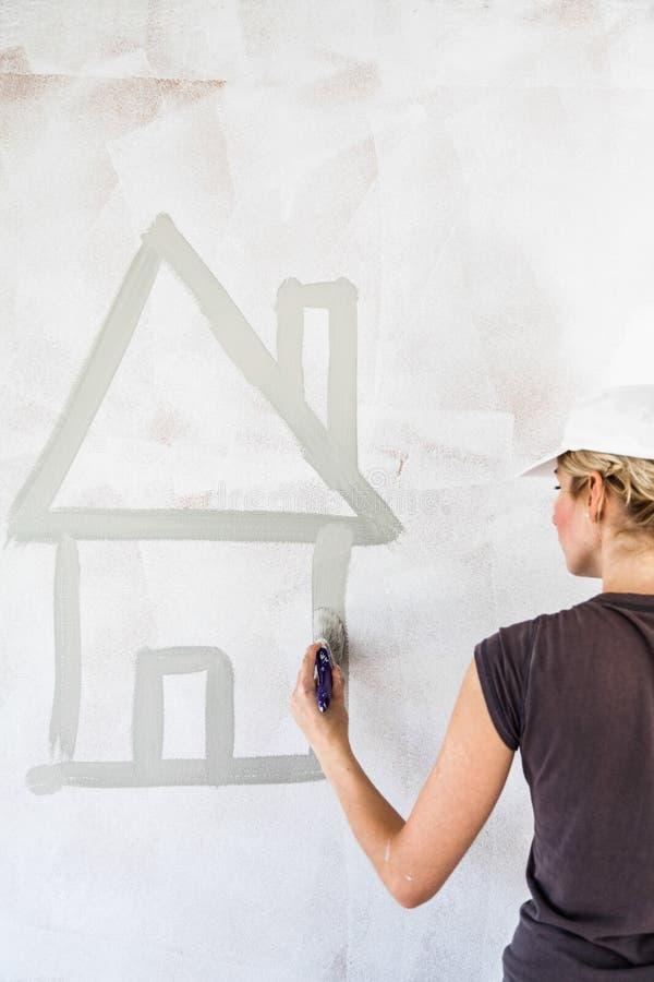 Skizze eines Hauses auf der Wand stockbild