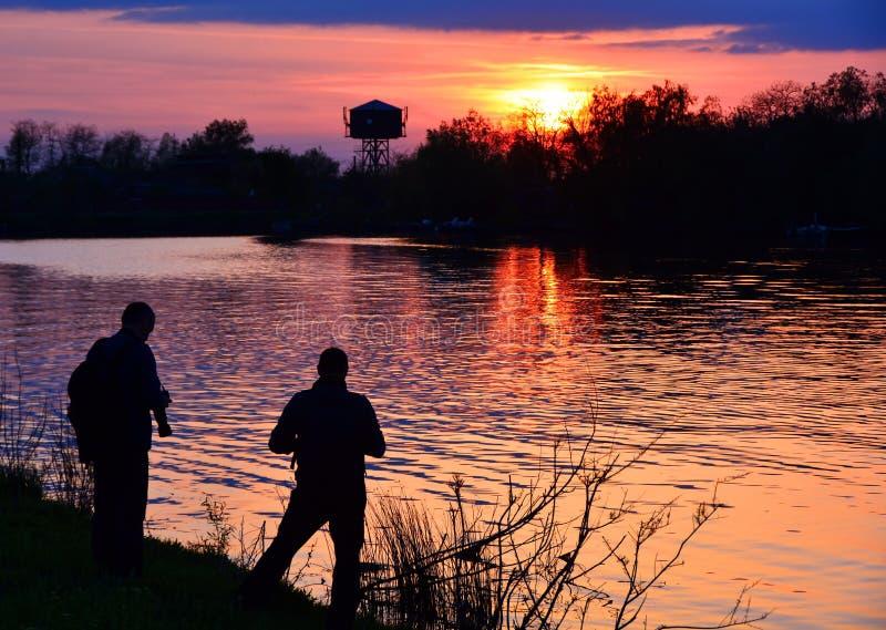 Skjuta på solnedgången arkivfoto
