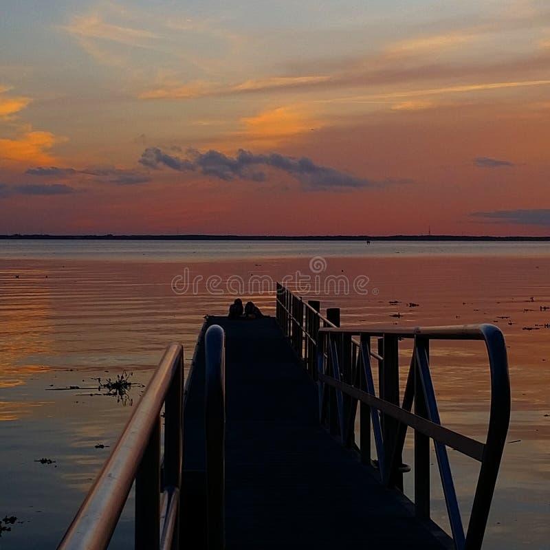 skjuten solnedgångtid för exponering long royaltyfria bilder