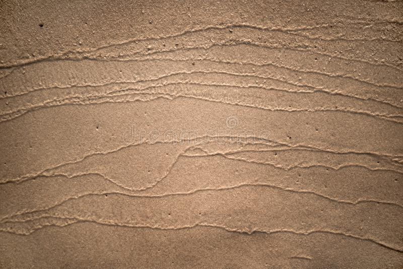 skjuten textur f?r bakgrundsstrand sand fotografering för bildbyråer