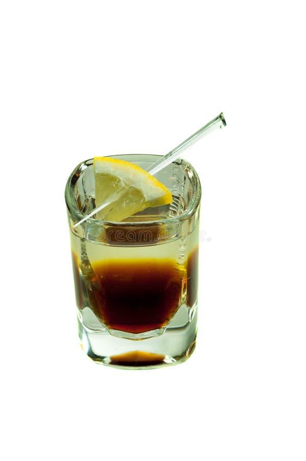 Skjutit exponeringsglas med koffeincoctailen royaltyfria bilder