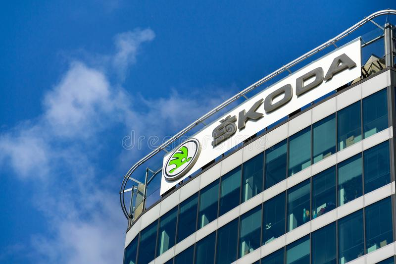 Skoda Auto automobile manufacturer from Volkswagen Group company logo on headquarters building. PRAGUE, CZECH REPUBLIC - OCTOBER 14: Skoda Auto automobile royalty free stock image